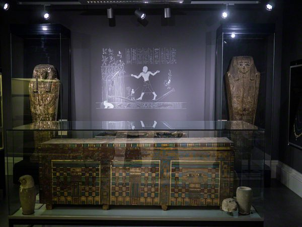 The back gallery, filled with objects related to death and the afterlife, including the coffin of Userhat, at the front of the photo