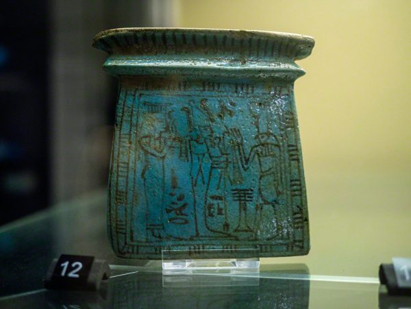 A faience pectoral, with Isis and Osiris before Horus. Unprovenanced (Acc. No. E.192)
