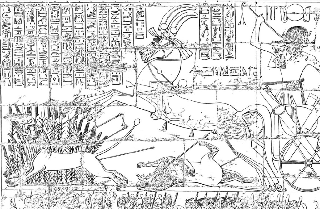 A line drawing of the scene, which has Rameses in a horse-drawn chariot hunting lions using a bow and arrow. A lion is running past a large bunch of flowering reeds. There are hieroglyphic inscriptions above the scene.