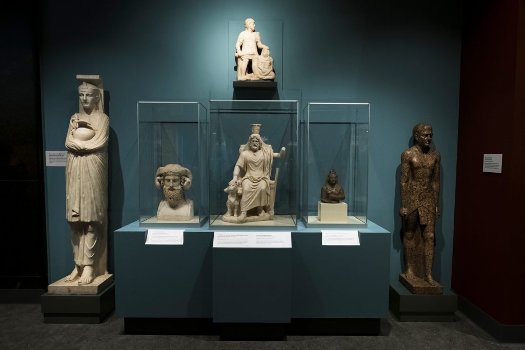 A collection of Greco-Roman sculptures of Egyptian pharaohs and deities