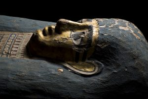 Profile of the head of a gilded ancient egyptian coffin