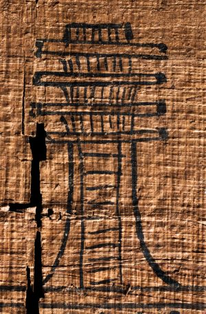 An ancient Egyptian djed-pillar in black ink on papyrus
