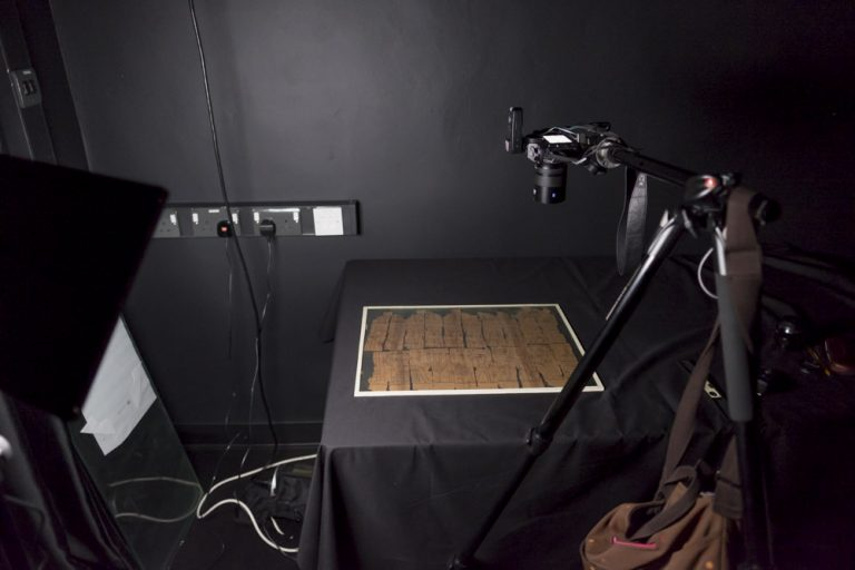 My camera on a tripod photographing a sheet of ancient Egyptian papyrus