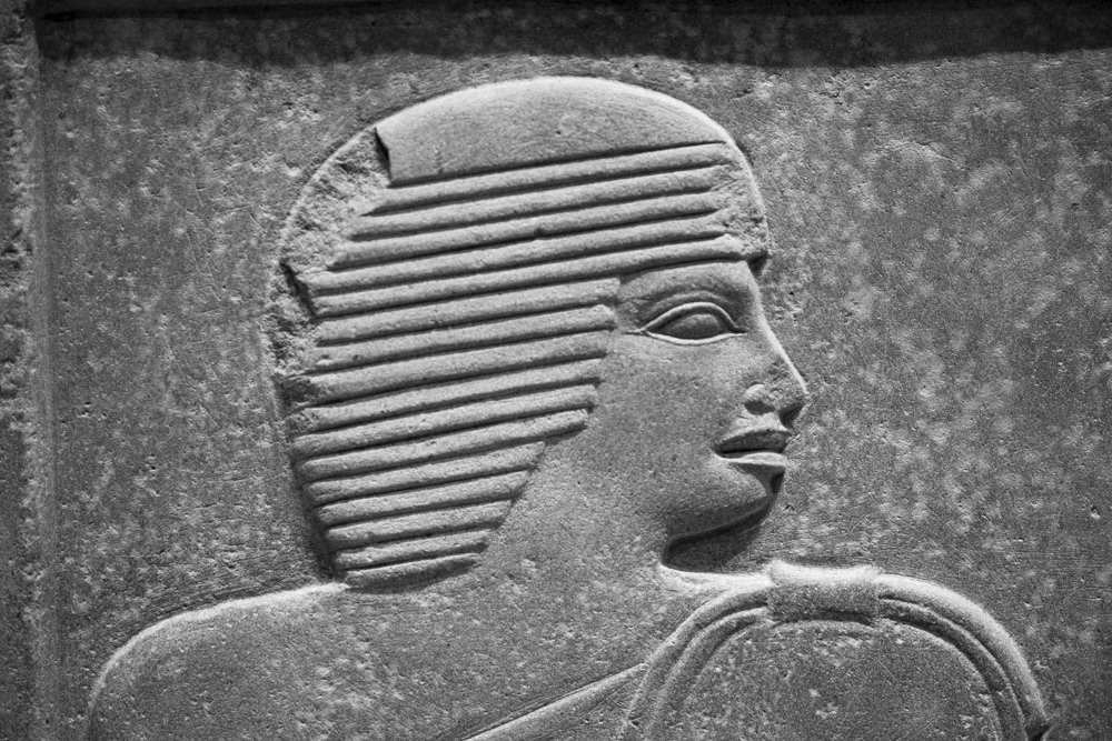 Close-up of a face in profile on an ancient Egyptian carved stone stela