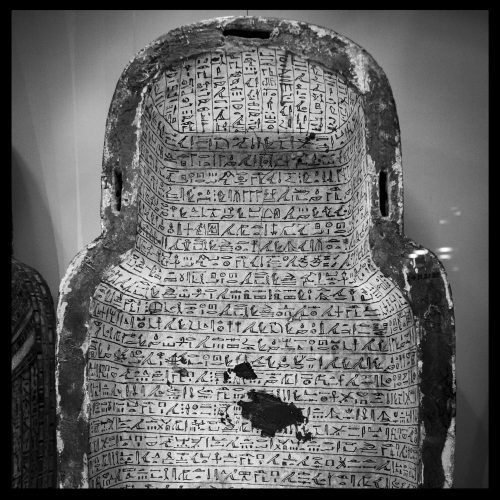 The inside of an ancient Egyptian coffin, covered in hieroglyphs