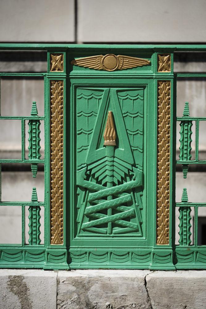 A rectangular wrought-iron panel with Egyptian Revival art deco design