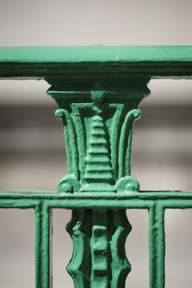 The top decoration on a wrought-iron fence with Egyptian Revival art deco design