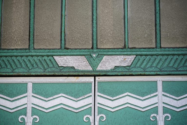 A triangular winged decoration on a door