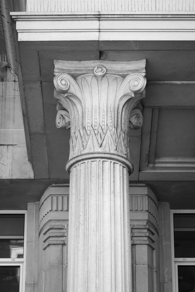 The capital of a column, carved with a mixture of ancient Egyptian and ancient Greek architectural elements