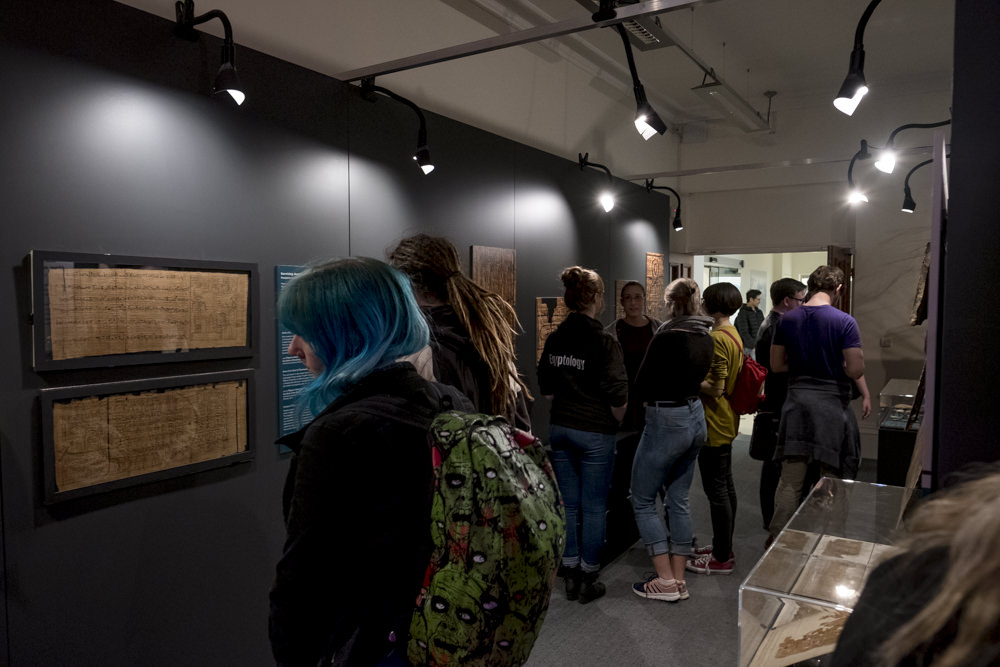 People visiting an exhibition of ancient Egyptian artefacts