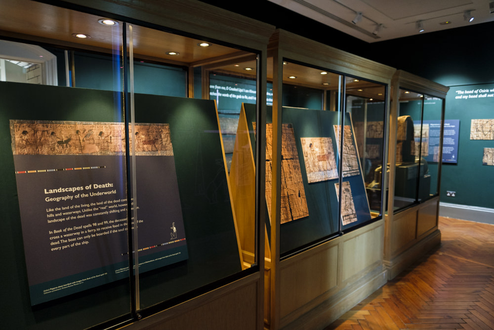 A museum gallery with images and artefacts from ancient Egypt