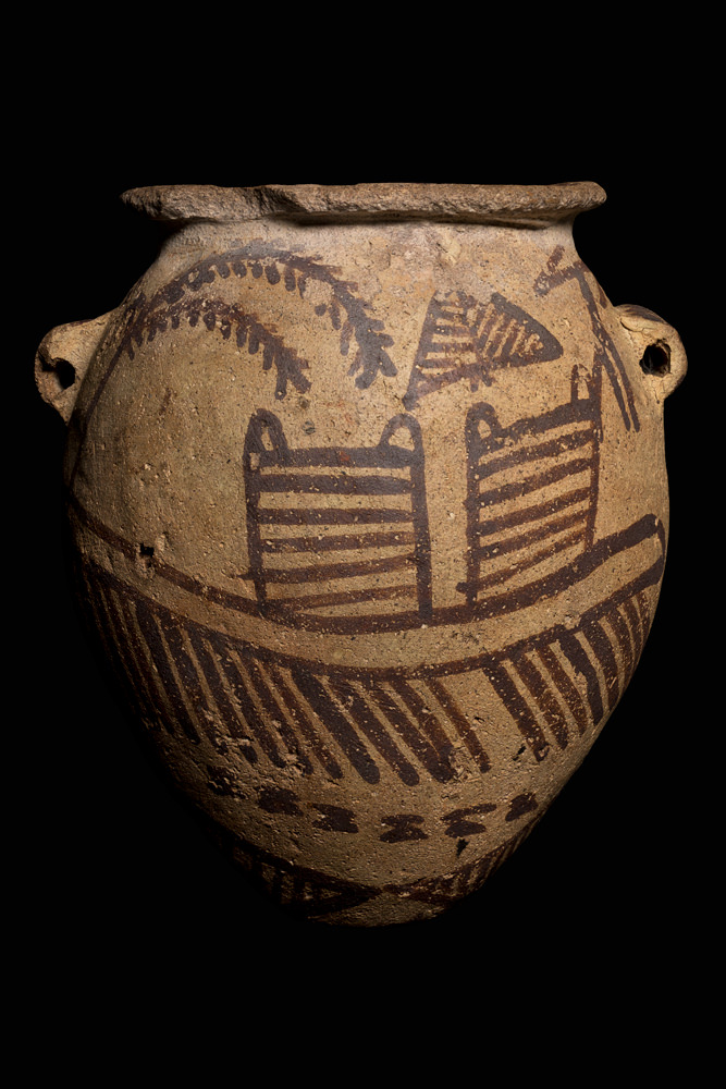 A small, ovoid pot with Predynastic images of a boat and trees