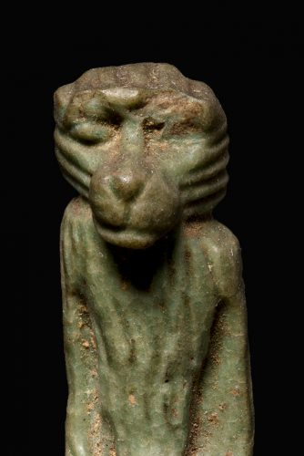 The top half of an ancient Egyptian amulet of a seated baboon