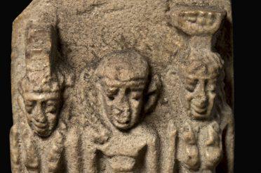 An Osirian triad amulet