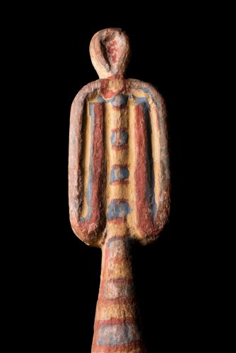 An ancient Egyptian tyet (Isis Knot) made from wood and painted