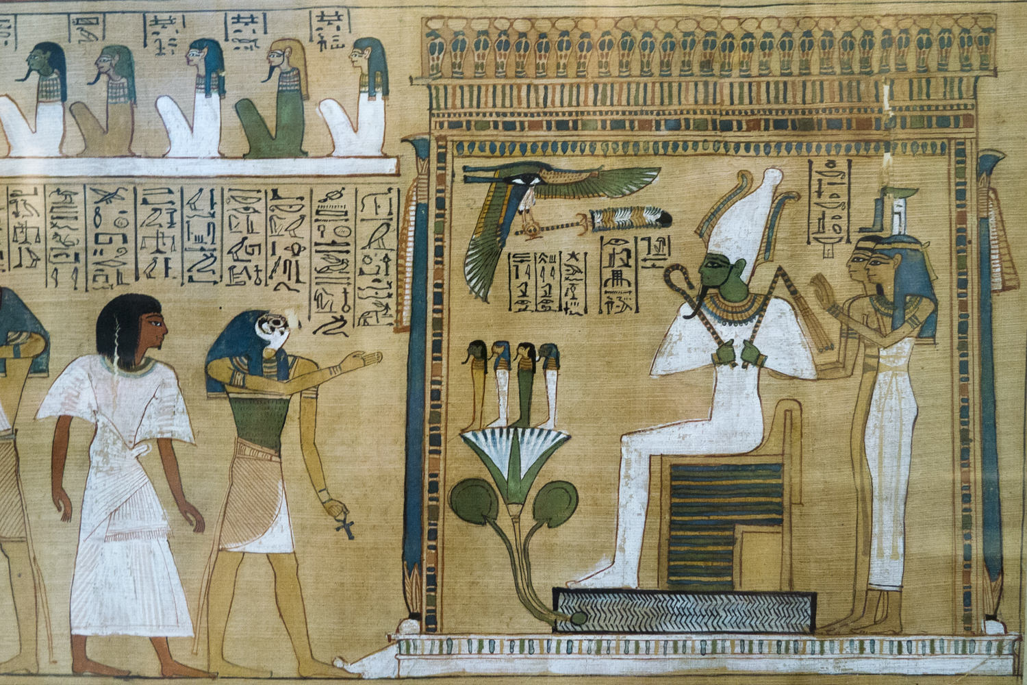 A page from the Book of the Dead showing the deceased before Osiris, Isis and Nephthys