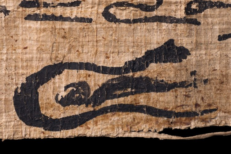 A detail of egyptian gods on a piece of papyrus