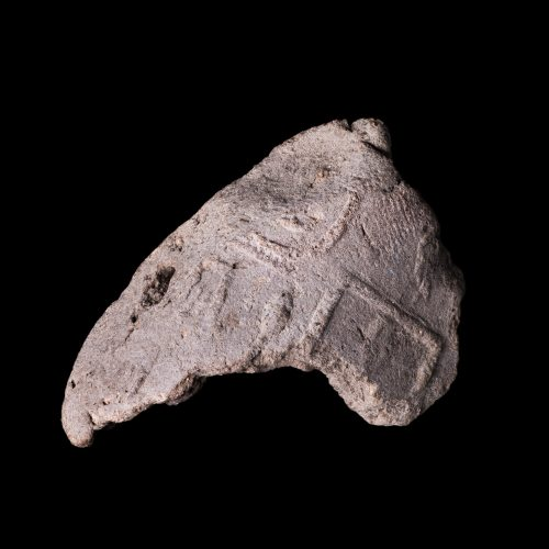 A tiny fragment of an ancient Egyptian clay seal with hieroglyphs