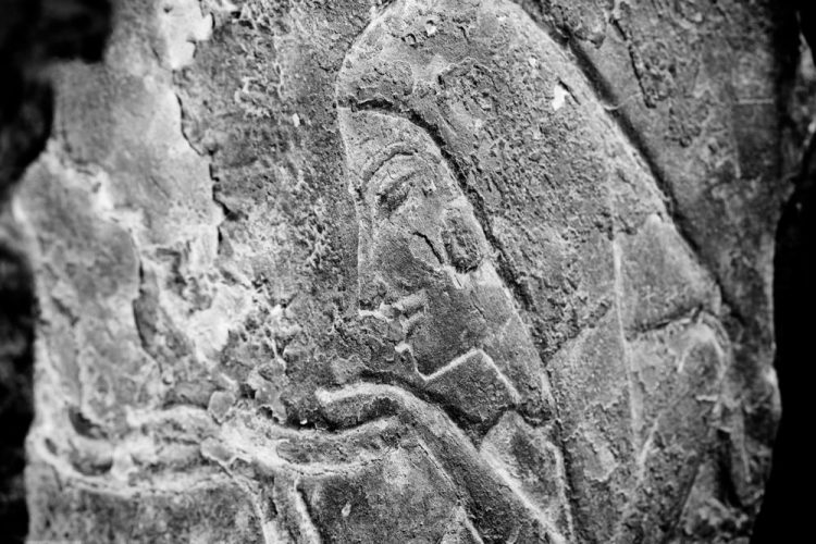 A classically ancient Egyptian face, carved in stone