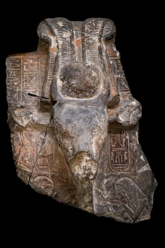 An ancient Egyptian carving of of the goddess Hathor as a cow. There are hieroglyphic inscriptions around her