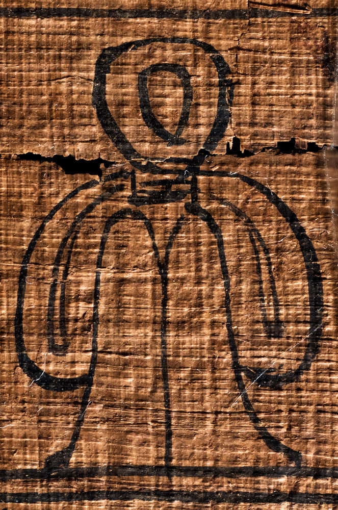 An Isis-knot, or tyet-knot, painted in black ink on a piece of papyrus