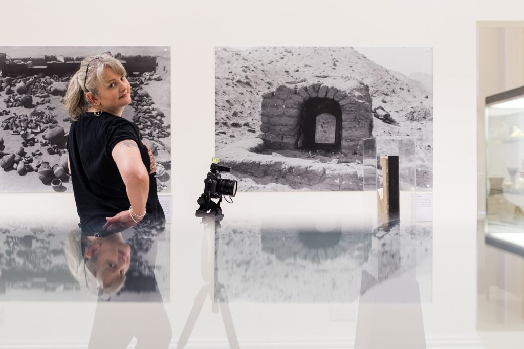 Julia Thorne with her camera in the Garstang Museum of Archaeology