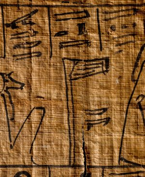 A netjer hieroglyph on a piece of ancient Egyptian papyrus
