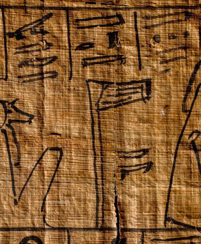 netjer hieroglyph on ancient Egyptian papyrus