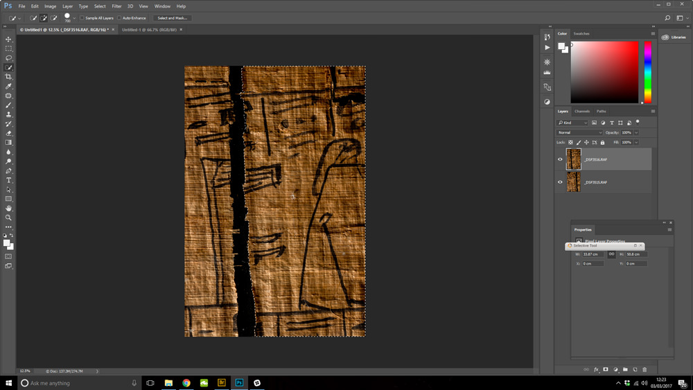 A screenshot of ancient Egyptian papyrus being 'repaired' in Photoshop