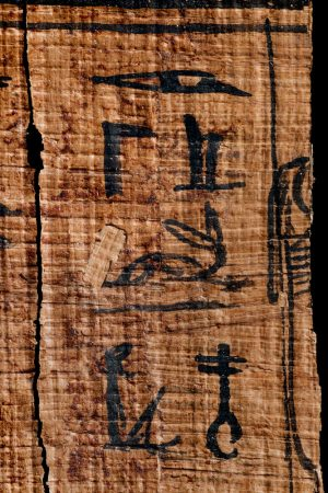 The name and epithet of Osiris in hieroglyphs on papyrus