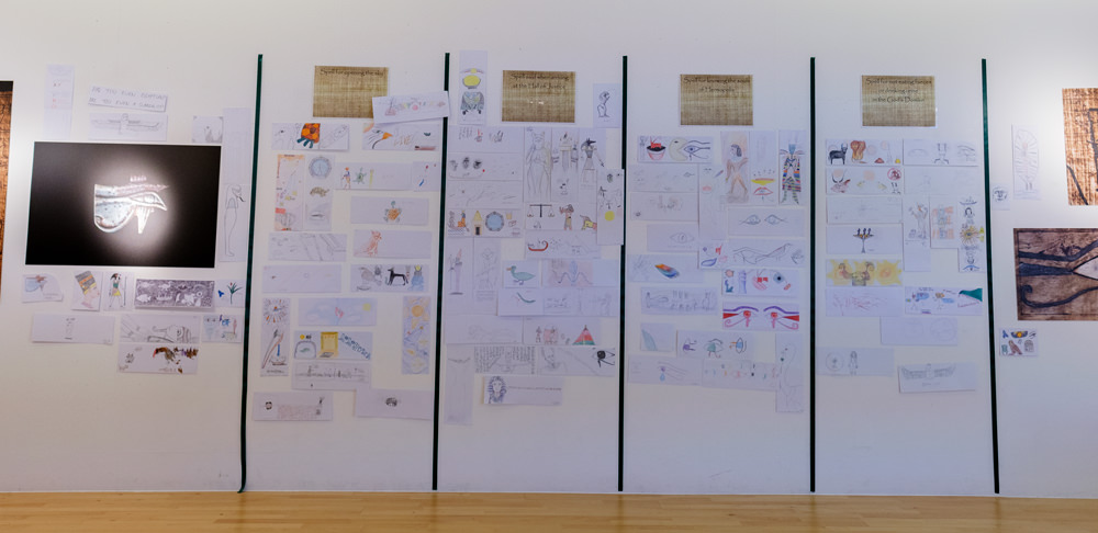 A wall covered in drawings