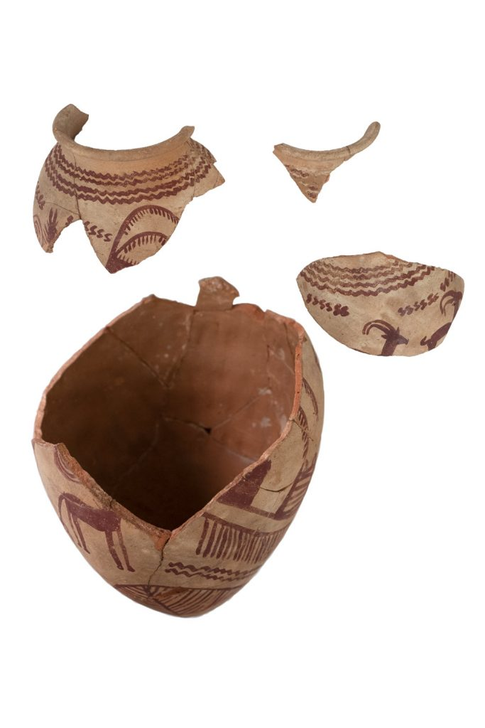 A large ancient Egyptian Predynastic pot with painted decoration, in pieces before conservation