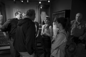 A group of people talking in the garstang museum of archaeology