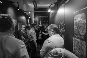 A group of people being given a tour at the garstang museum of archaeology