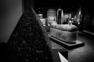 A couple looking at an Egyptian sarcophagus in the world museum