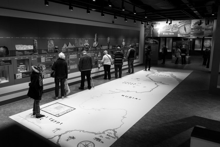 People looking at the timeline in the egyptian gallery at the world museum