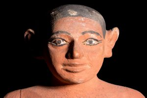 The head and shoulders of an ancient Egyptian tomb model of a man