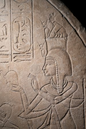 Detail of an ancient egyptian priestess on a limestone stela