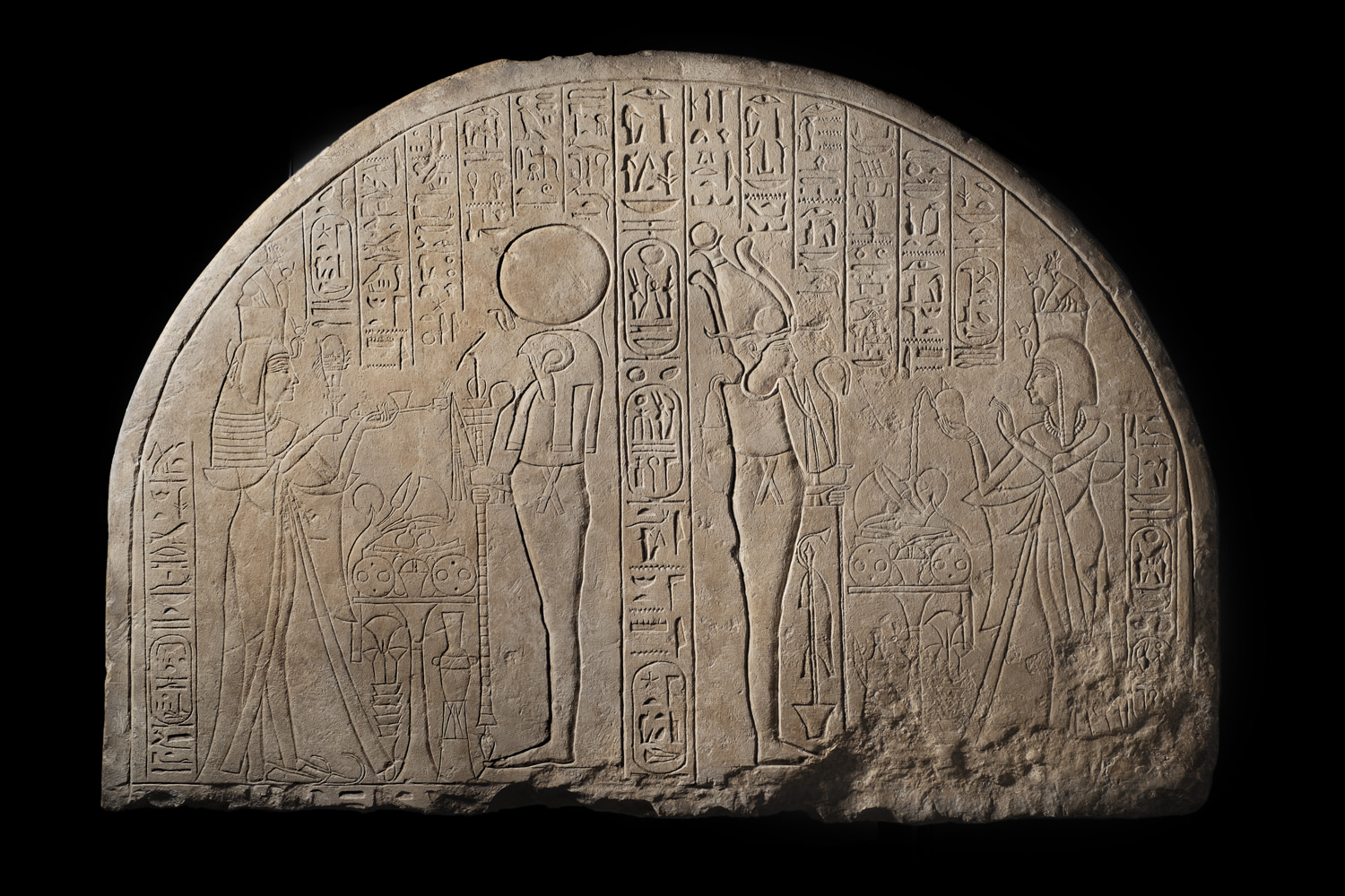 an ancient egyptian inscribed stela with hieroglyphs