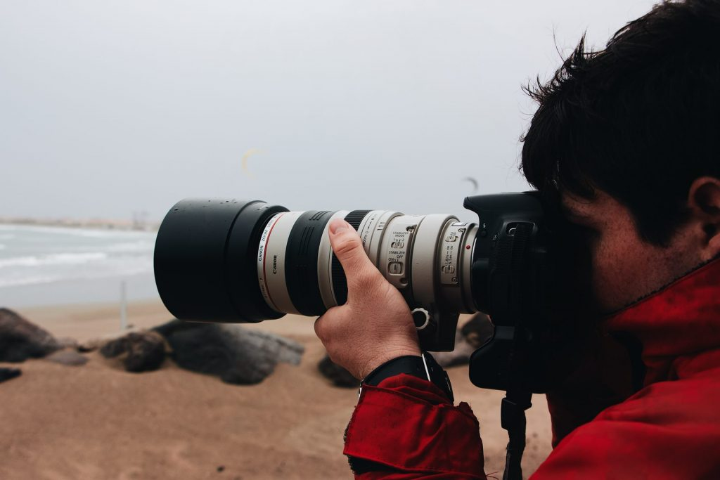 man taking a photo with a canon dslr