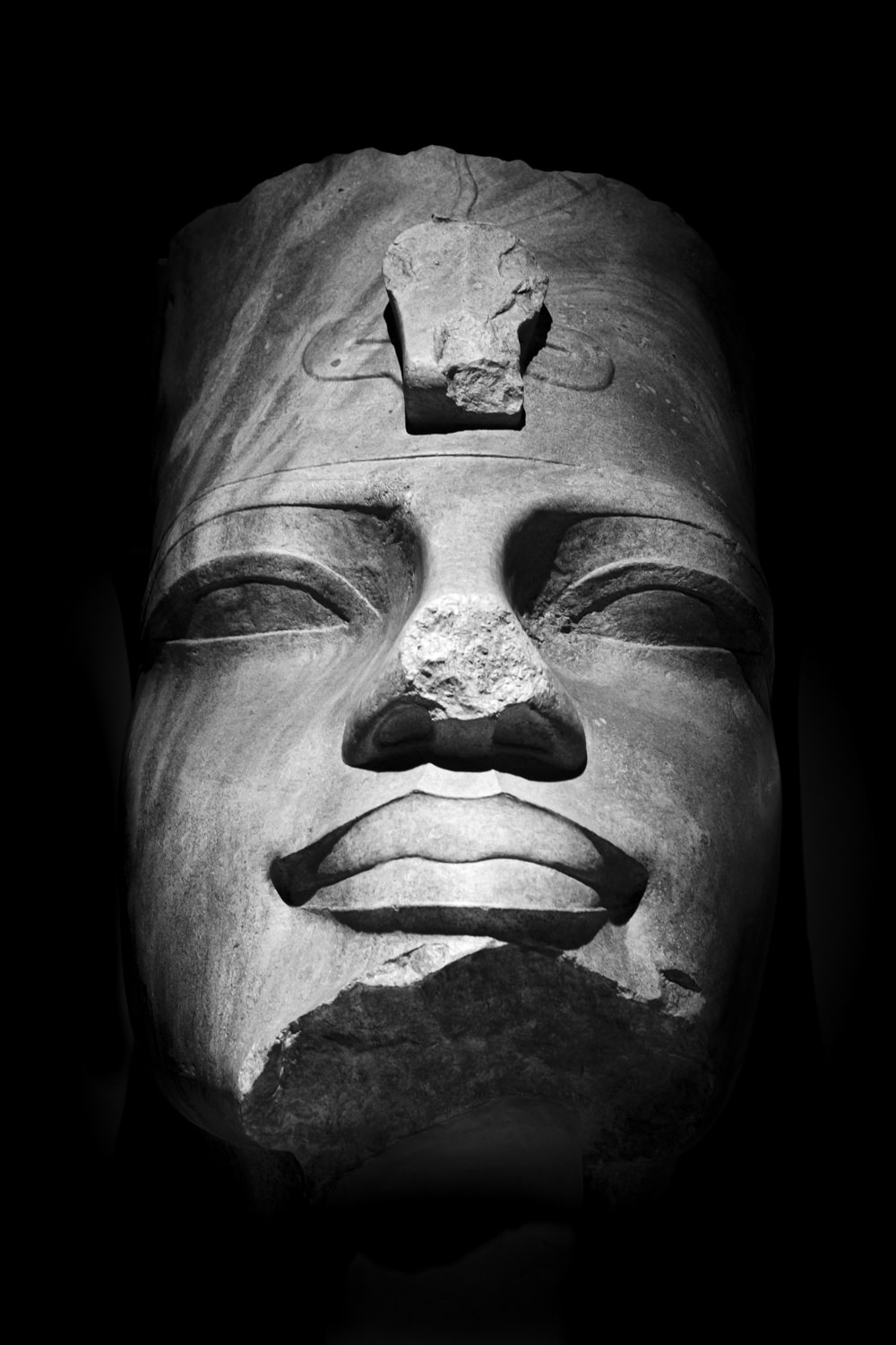 an ancient egyptian sculpture of a pharaoh's head
