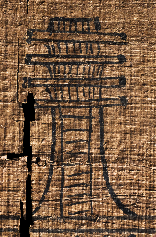 an egyptian djed pillar on papyrus