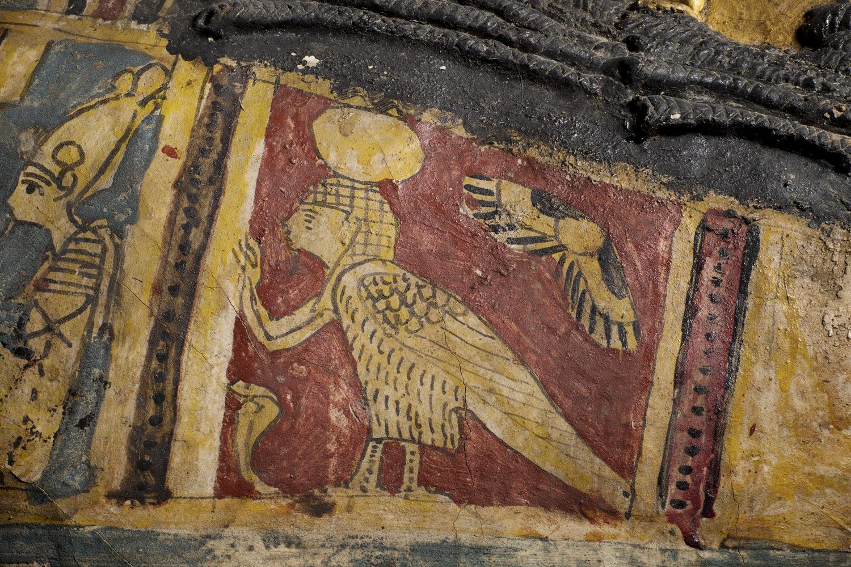 an ancient egyptian ba bird on a coffin