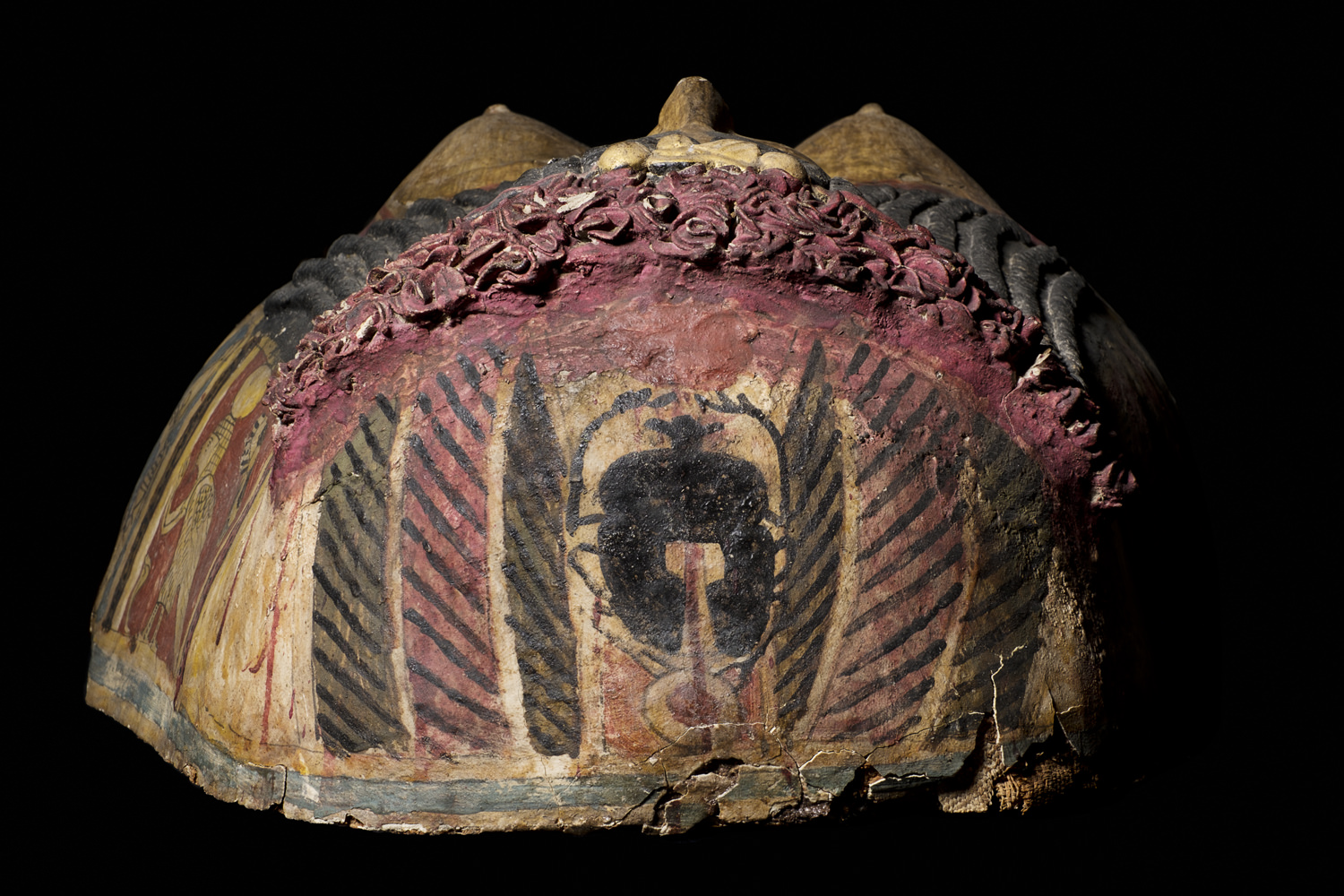 ancient egyptian cover for a mummy with a scarab beetle