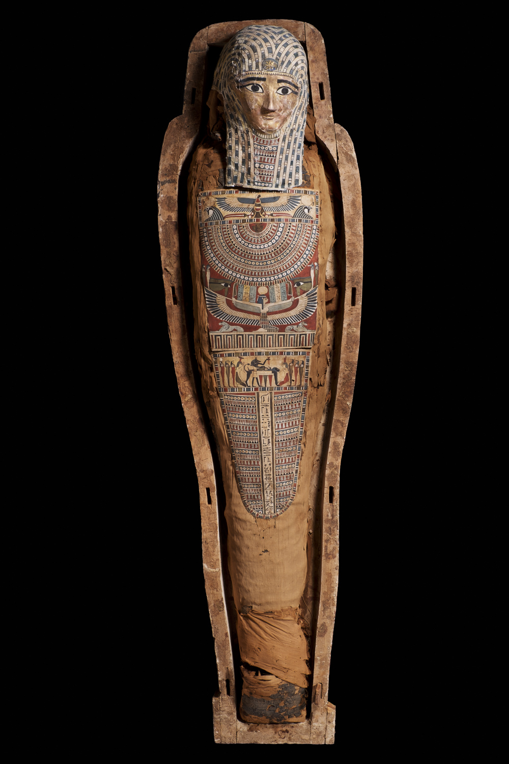 an ancient egyptian wrapped mummy in a coffin