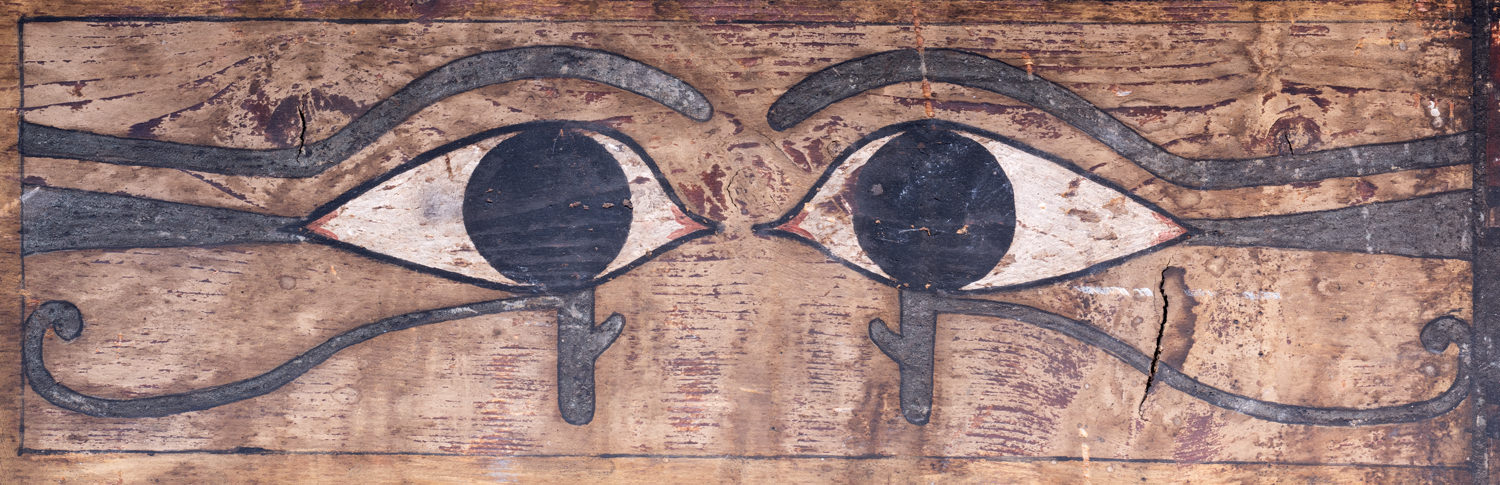 ancient egyptian eyes painted on a wooden coffin
