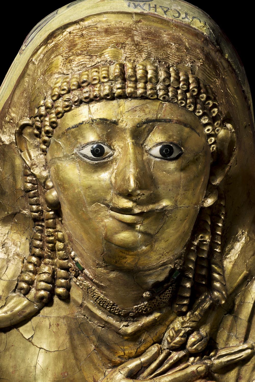 an ancient egyptian gilded mummy