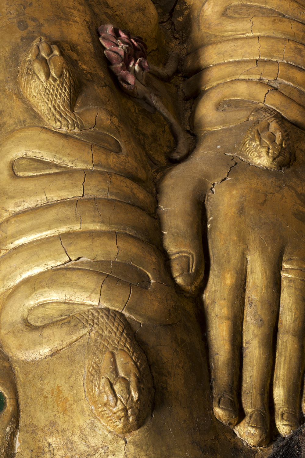serpent armbands on a gilded ancient egyptian coffin
