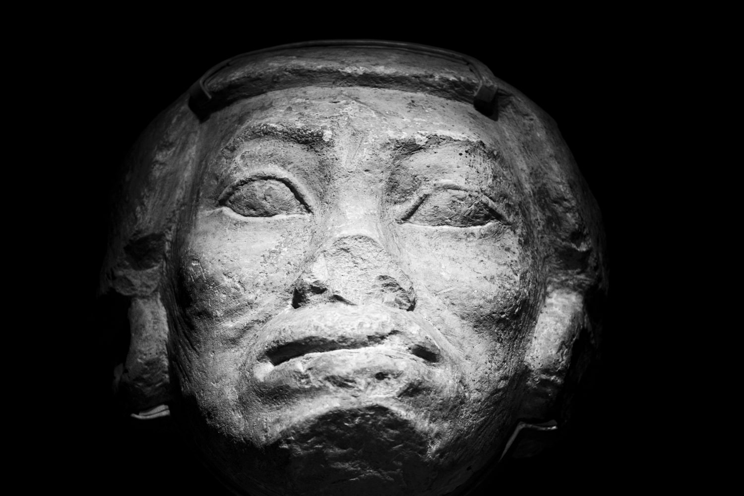 the limestone head of an egyptian statue