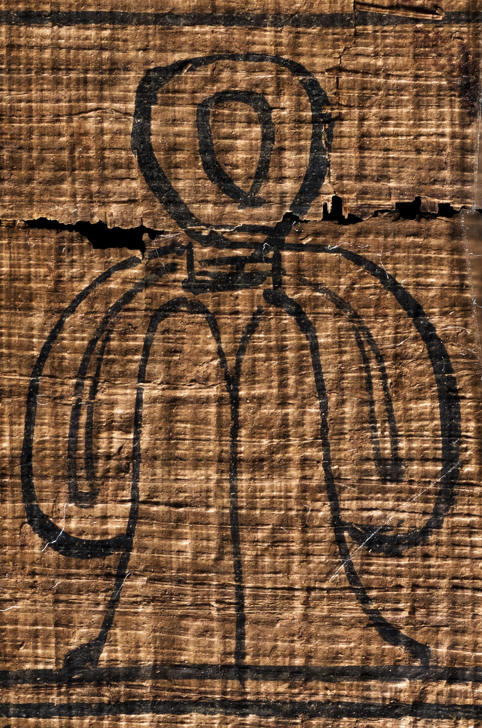 an egyptian tyet (isis knot) on papyrus